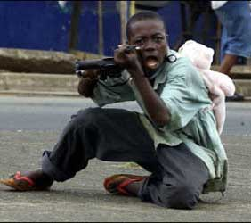 Child soldier wearing a teddy bear backpack